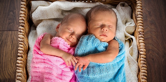 The benefits of placing twins in the same crib