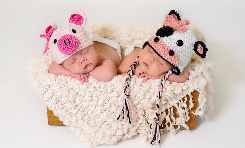 twins wearing crocheted animal hat
