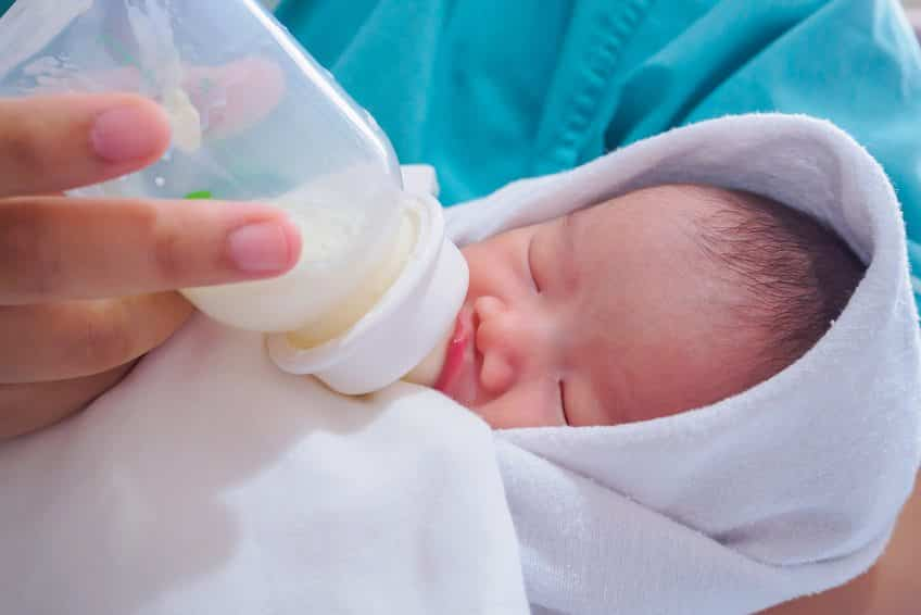 feeding a baby breastmilk out of a bottle